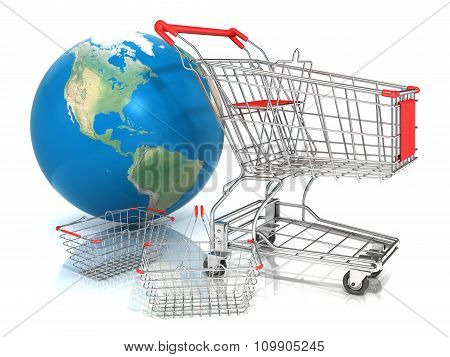 Steel wire shopping baskets and shopping cart in front of globe isolated on a white background