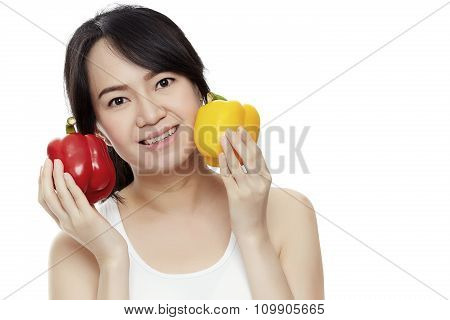 The Young Woman Holding Peppers On A White Background.