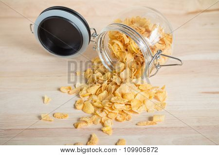 cereal cornflakes spilling out from the glass jar