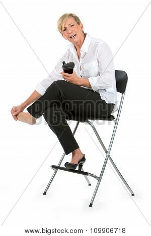 Businesswoman With Sore Feet Sat On A Chair