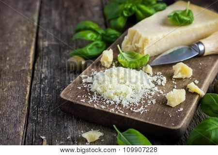 Parmesan Cheese On Wooden Cutting Board
