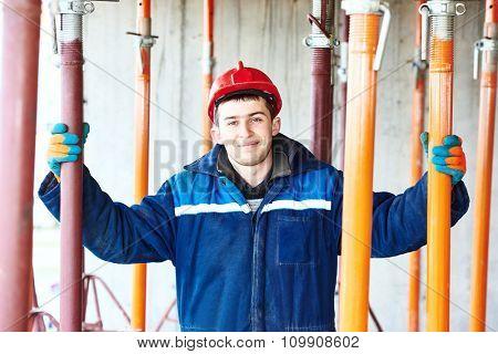 Male construction builder labours worker portrait at building site