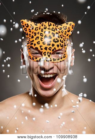 Portrait Of Young Man In A Leopard Mask
