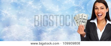 Happy laughing woman holding cash over blue background