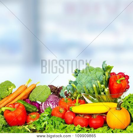 Fresh Vegetables and fruits over blue background. Healthy diet.