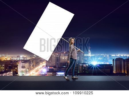 Teenage girl with large white banner
