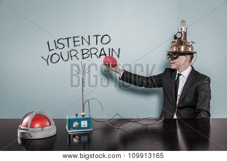 Listen to your brain concept with businessman holding brain