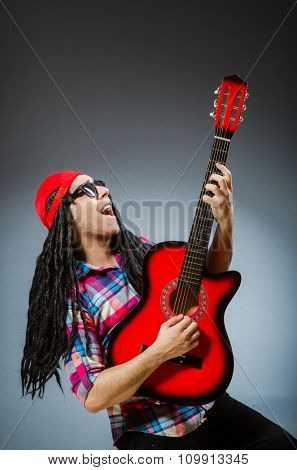 Funny man playing guitar in musical concept
