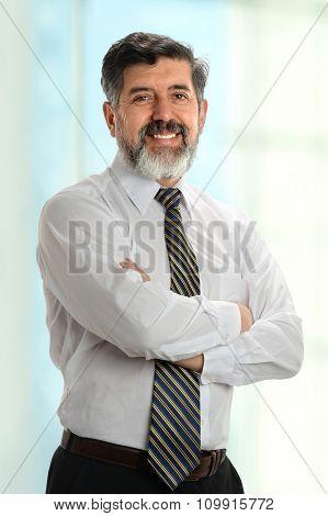 Portrait of mature Hispanic businessman inside office building