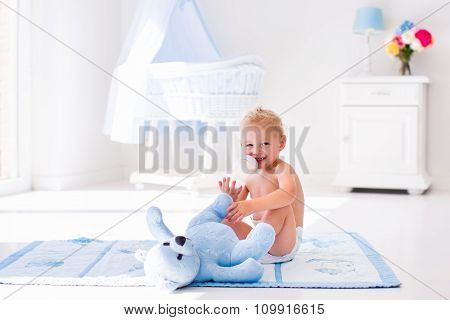 Baby Boy With Milk Bottle In Sunny Nursery