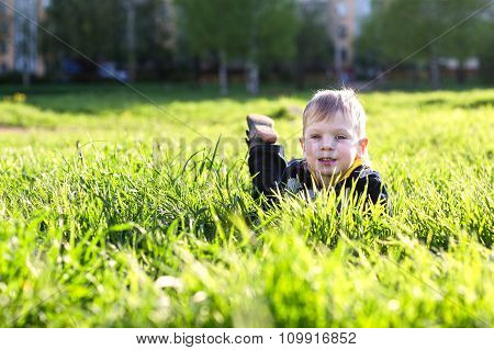 Boy On The Grass.
