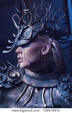 Woman in steel costume and head wear