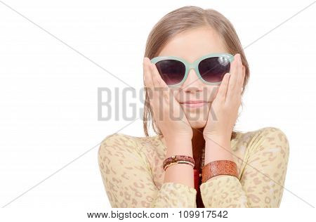 Portrait Of A Smiling Little Girl With Sun glasses  On  White Background
