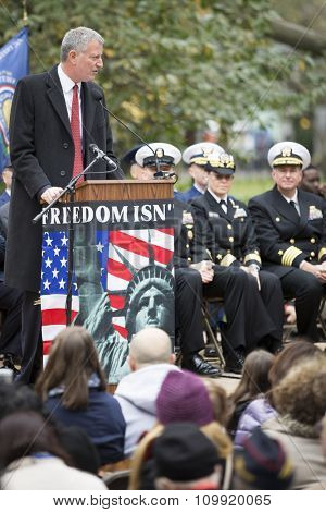 NEW YORK - NOVEMBER 11 2015: New York City Mayor Bill De Blasio speaks to the audience at the opening ceremony in Madison Square Park before the annual Americas Parade up 5th Avenue on Veterans Day.