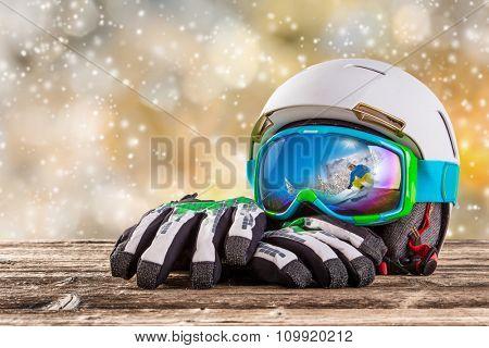 Colorful ski glasses, gloves and helmet