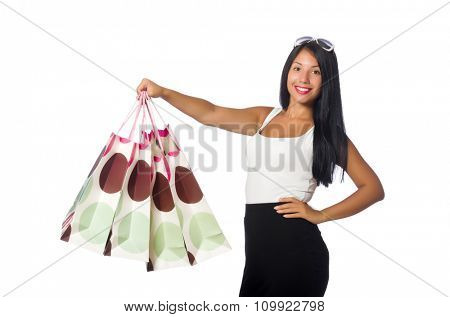 Woman with shopping bags on white