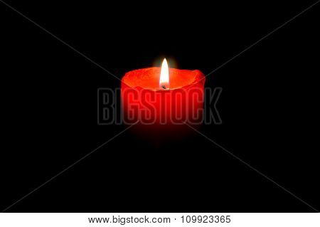Burning Red Candle In Total Darkness