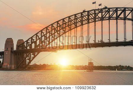 Sun sets over Harbour Bridge in Sydney, Australia