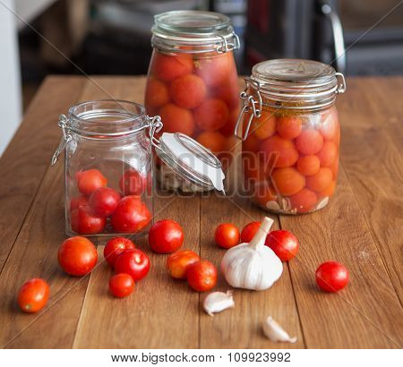 pots of marinated tomatoes