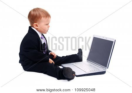 Happy boy using laptop computer