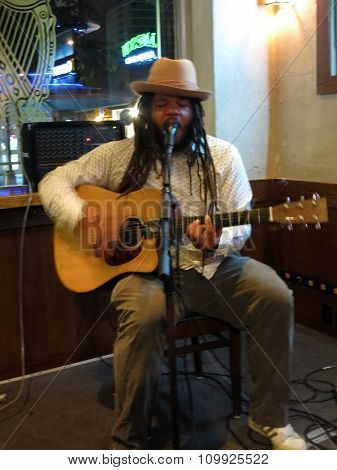 Reggae Musician Keith Batlin Sings And Plays Guitar As He Jams At The Kelley O'neil's