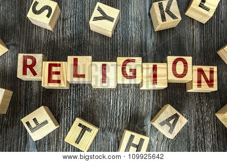 Wooden Blocks with the text: Religion