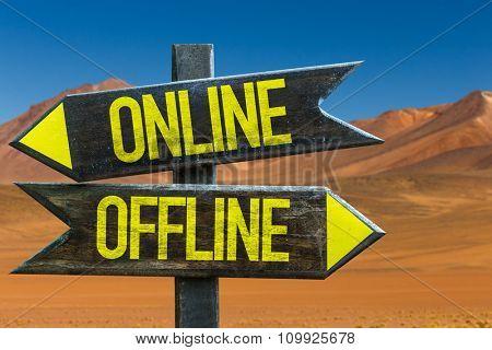 Online - Offline signpost in a desert background