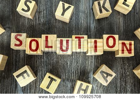 Wooden Blocks with the text: Solution