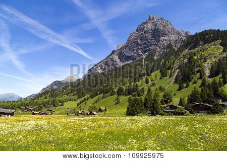 Panorama View Of The Alps And Bluemlisalp On The Hiking Path Near Kandersteg On Bernese Oberland In