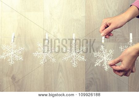 Woman Hand Creating Christmas Decoration Indoor