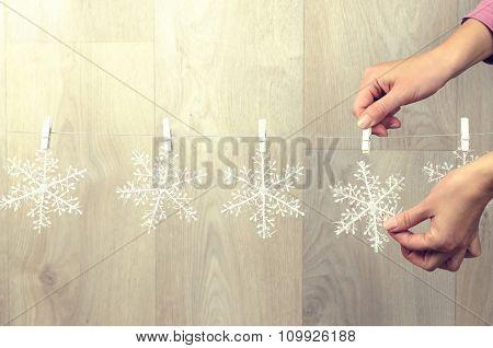 Woman Hand Creating Christmas Decoration Indoor