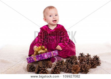 Beautiful baby girl in red dress in New Year's Eve