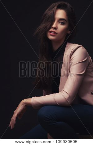 Pretty young lady in pink suit