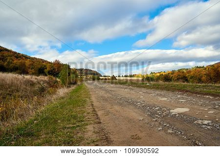 Mountain Road Lanscape With Clouds And Colorful Trees