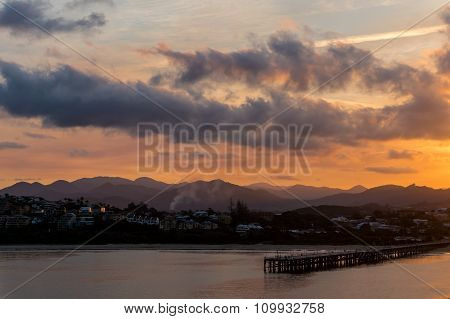 Coffs Harbour beautiful marina view with pier and city at sunset