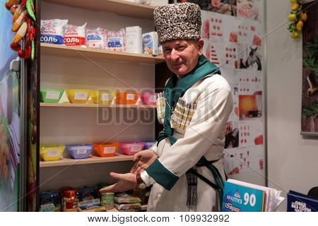 ST. PETERSBURG, RUSSIA - NOVEMBER 18, 2015: Vendor presenting salts and spices in the food exhibition PeterFood. The exhibition is setting up contacts between food manufacturers and retail networks