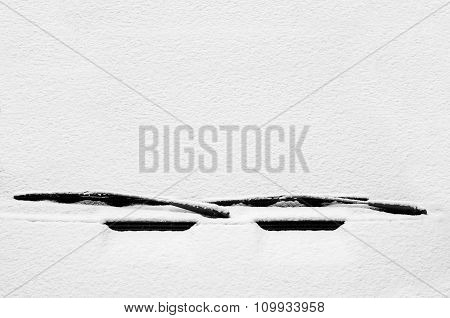 Car windscreen covered with snow