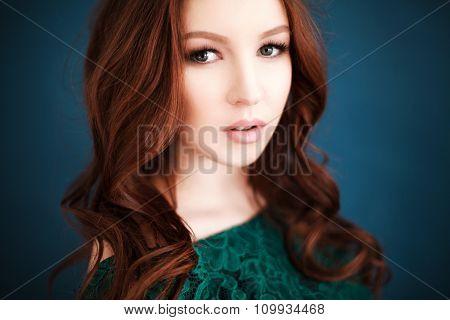 Portrait of beautiful woman in green lace dress