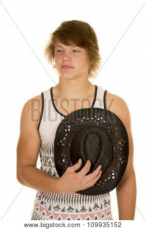 Young Cowboy With Hat Over Heart