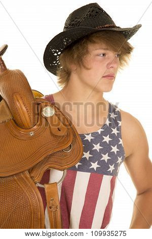 Young Cowboy In Striped Shirt Saddle On Shoulder