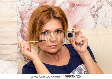 Beautiful Middle-aged Woman Holding A Eyeliner.