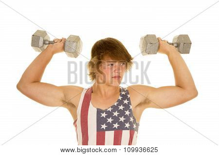 Young Man In Striped Tank Top Weights Flexed