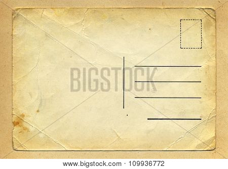 Vintage wrinkled old school grungy postcard on handmade beige paper background texture. Burned brown edges gradient.