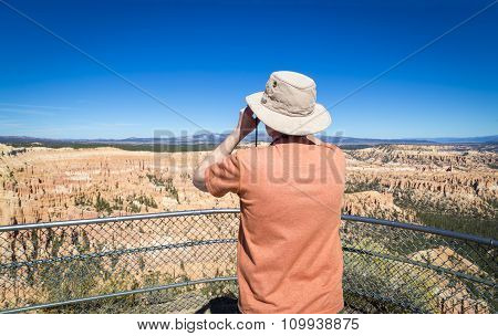 A Tourist Looking At Bryce Canyon