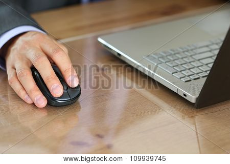 Hands Of Businessman In Suit Holding Computer Wireless Mouse