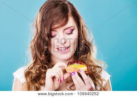 Cute Girl Holds Fruit Cake In Hand On Blue