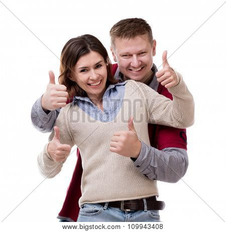 smiling couple with thumbs up isolated on white background