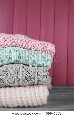 Hand made clothes on wooden wall background