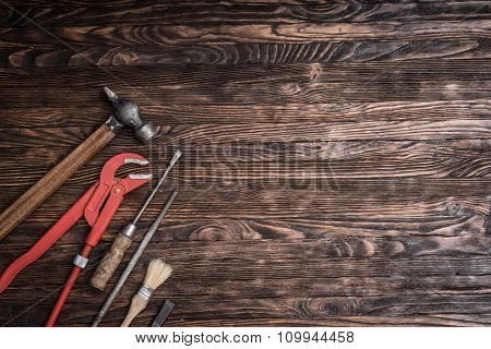 set of instruments for repairing on wooden background with text space
