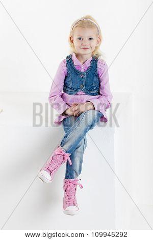 sitting little girl wearing jeans